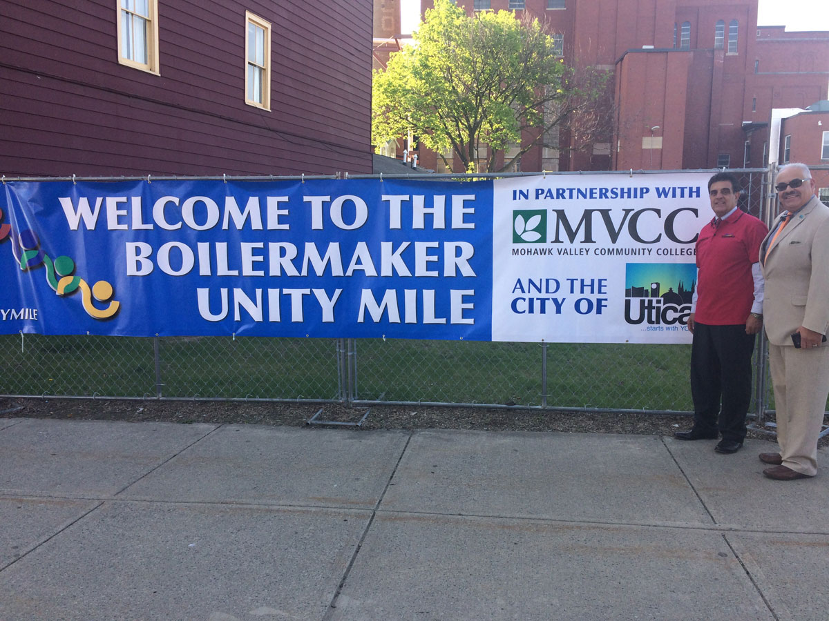 Mayor Palmieri and Tony Colon unveiling the new Unity Mile along the Boilermaker race course.