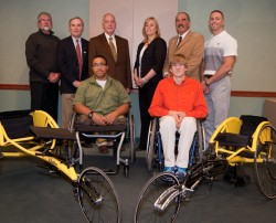 Boilermaker Wheelchair Challengers Anthony Grieco, of Utica (front left), and Cody Arnold, of Syracuse, (front right), proudly accept their new racing wheelchairs during a formal presentation at Sitrin.  Also pictured are (back row, from left) Jim Stasait