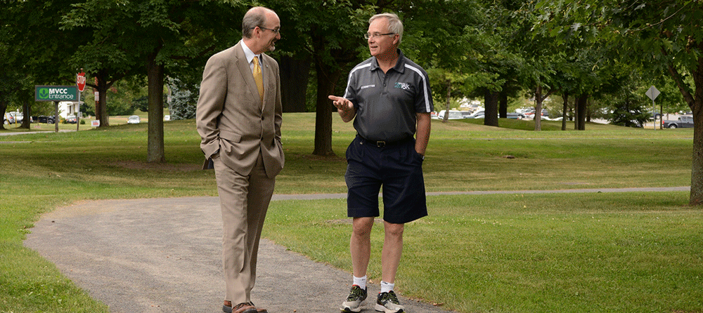 MVCC President Randall VanWagoner and Boilermaker CEO Tim Reed walk along the MVCC walking track at the College's Utica campus.